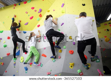 MINSK, BELARUS - SEPTEMBER 16, 2016: A family testing new indoor climbing wall