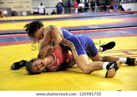MINSK, BELARUS - SEPTEMBER 16: Unidentified female wins by fall during Grand Prix for the prizes A.Medved in freestyle wrestling on September 16, 2012 in Minsk, Belarus. - stock photo