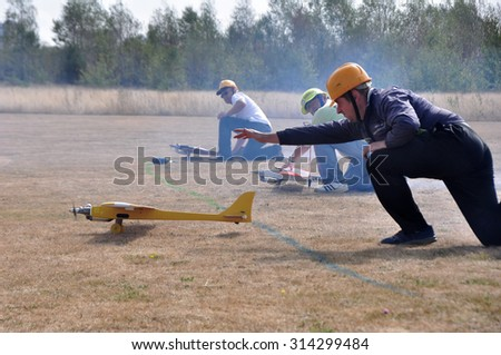 """MINSK, BELARUS â?? SEPTEMBER 5 Unidentified sportmen on start on the """"USSR Cup 2015"""" (Competition racing radio-controlled model classes F3D and Q500) on September 5, 2015 in Minsk, Belarus. - stock photo"""
