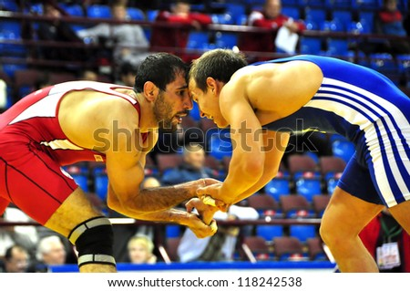MINSK, BELARUS - SEPTEMBER 16: Unidentified wrestlers compete during Grand Prix for the prizes A.Medved in freestyle wrestling on September 16, 2012 in Minsk, Belarus. - stock photo