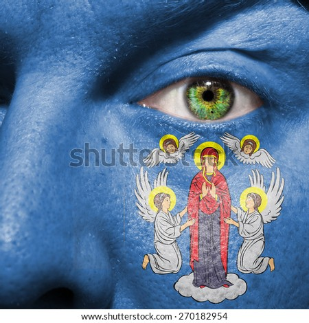 Minsk la Vella flag painted on a man's face to support his city Minsk - stock photo