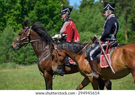MINSK REGION, BELARUS - JUNE 6: Russian lancers taking part in the historical reconstruction of fight in napoleonic war between Russian and French armies in 1812. June 6, 2015, Mejdurechye, Belarus