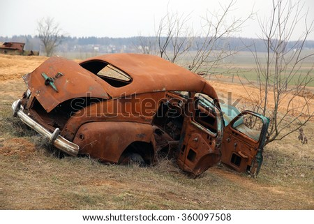 MINSK REGION, BELARUS - MARCH 29, 2015: Abandoned GAZ-M20 Pobeda wrongfully imitates a WWII victim at the Stalin Line Museum. The model appeared in 1946.