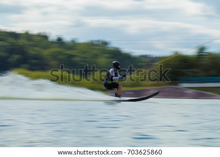 MINSK, REPUBLIC OF BELARUS - AUGUST 17, 2017: Competitions on water skiing. Photo with texture high speed effect with blur background for design.