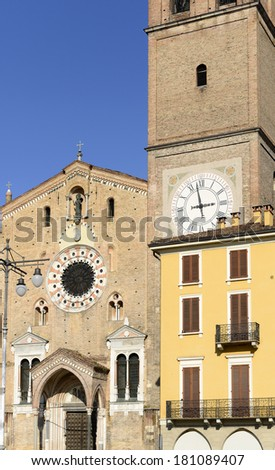 Minster and building on market square, Lodi, Italy; foreshortening  of the Romanesque Cathedral of the small town on the square and of old building near it ; shot in bright winter light