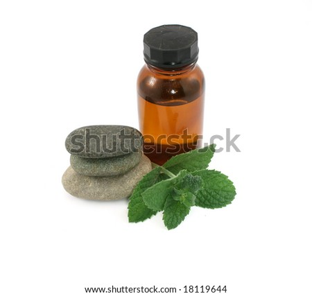 mint and bottle isolated on white