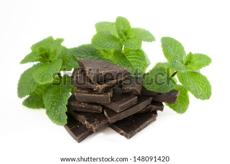 Mint and chocolate isolated on white