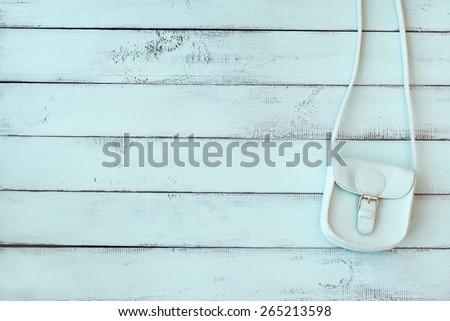 Mint fashion women bag hanging on the shabby chic background wall - stock photo