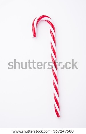 Mint hard candy cane striped in Christmas colours isolated on a