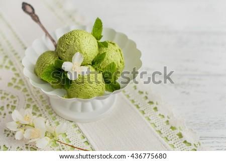 Mint ice cream on wooden background - stock photo