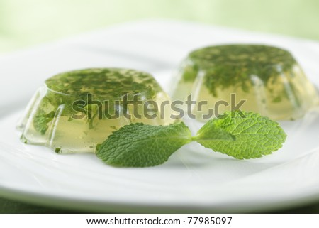Mint jelly on the plate with fresh leaf of peppermint. Shallow DOF