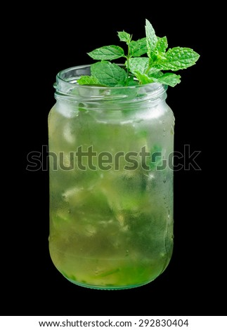 Mint Julep is a cocktail that contains bourbon, powdered sugar, water and mint. Garnished with a mint twig. Isolated on black. - stock photo