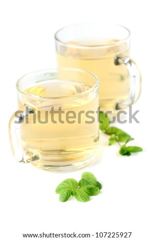 Mint leaf and freshly made mint tea in glass cups isolated on white background. Shallow dof