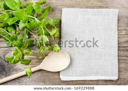 Mint leaves on wooden table - stock photo