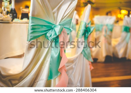 mint stylish luxury decorated chairs for the celebration for a wedding of happy couple, cathering in the restaurant - stock photo