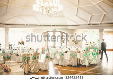 mint stylish luxury decorated tables for the celebration for a wedding of happy couple, cathering in the restaurant - stock photo