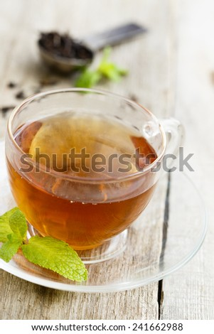 Mint tea in glass cup - stock photo