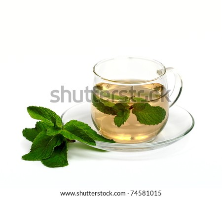 Mint tea with fresh mint leaves isolated on white background.