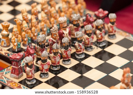 Minute chess figures lined up on a board, Sacred Valley, Peru - stock photo