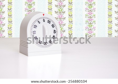 Minute timer on kitchen counter top - stock photo