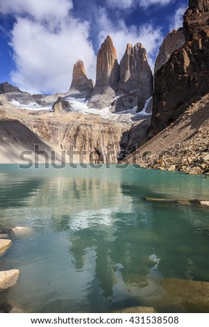 Mirador Torres and its reflection ob the lake, Torres del Paine National Park, Chile - stock photo