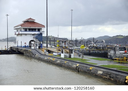 MIRAFLORES LOCKS, PANAMA CANAL-NOV. 7: Miraflores is the name of one of the three locks that form part of the Panama Canal. On nov. 7 2012 in Panama. Ships are raised a total of 87 feet above sea. - stock photo