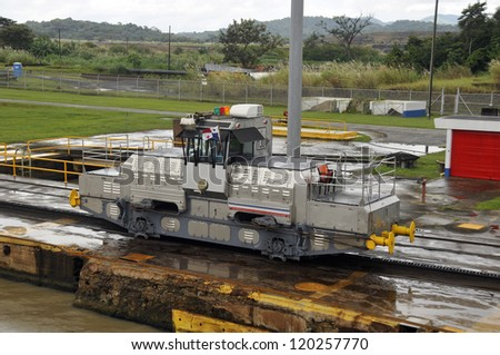 MIRAFLORES LOCKS, PANAMA CANAL-NOV. 7: Trains (mules) side Panama Canal.  These mules are used for side-to-side and braking control in the rather narrow locks On nov. 7 2012 in Panama. - stock photo