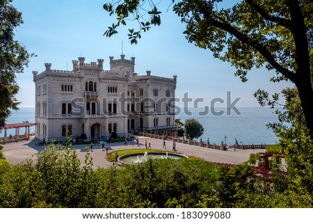 Miramare castle and gardens with vegetation frame in italy - stock photo