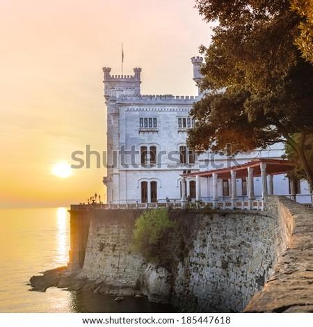 Miramare Castle, Castello di Miramare, in sunset. it is a 19th century castle on the Gulf of Trieste near Trieste, Italy. It was built for Austrian Archduke Ferdinand Maximilian. - stock photo