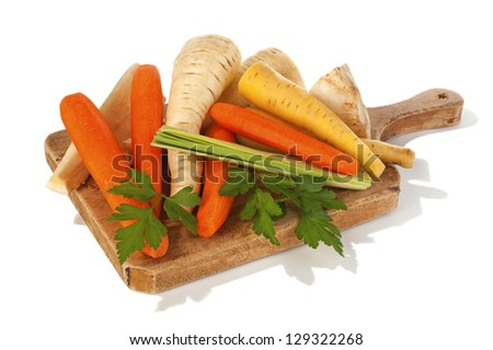 mirepoix on wooden cutting board - stock photo