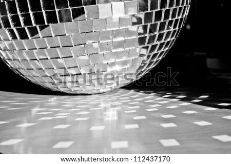 Mirror ball sitting on table - stock photo