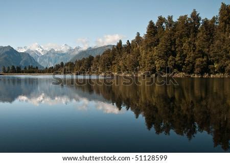 mirror image of matheson lake - stock photo