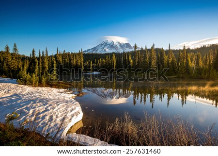 Mirror like reflection and mount Rainier in background - stock photo