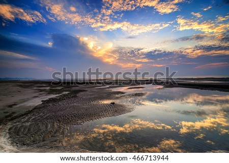Mirror-like reflection during awesome sunrise with stunning colors & clouds. Copyspace is available.
