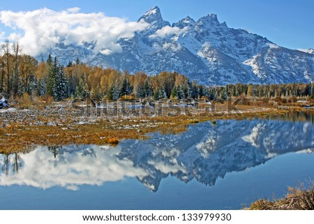 Mirror reflection with mountains and clouds, Grand Teton National Park, Wyoming