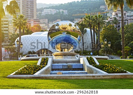 Mirror sphere reflecting building of Monte Carlo Grand Casino at sunset, Monaco - stock photo