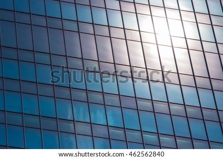 mirror window office building with sun flare reflection background