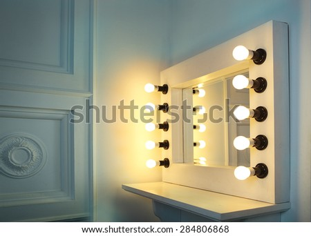 Mirror with bulbs for make up in the make up room - stock photo