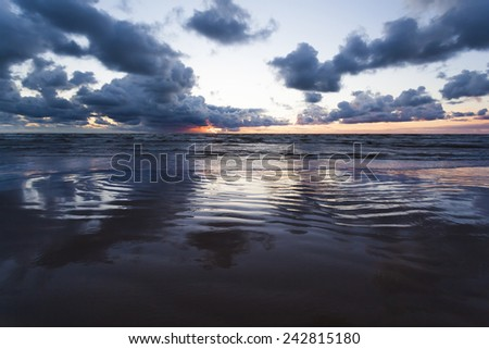 Mirrored sunset at baltic sea. Riga, Latvia - stock photo
