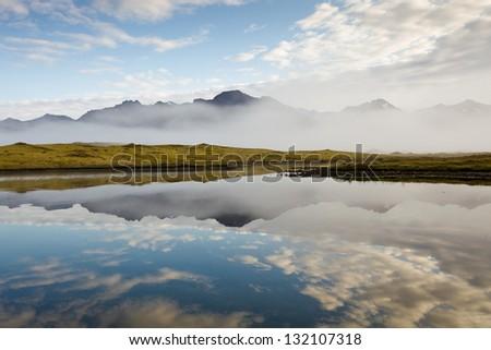 Mirroring lake - stock photo