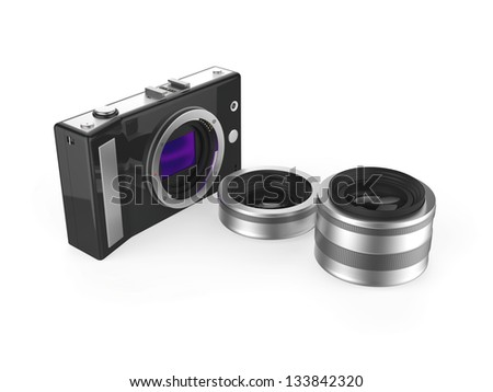 Mirrorless camera with prime and zoom lenses - stock photo