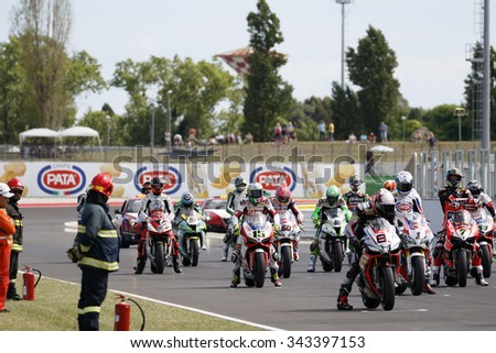 Misano Adriatico, Italy - June 21, 2015: Bikes prepare to leave the grid at the start during race one at the Misano World Circuit  on June 21, 2015 in Misano Adriatico, Italy.