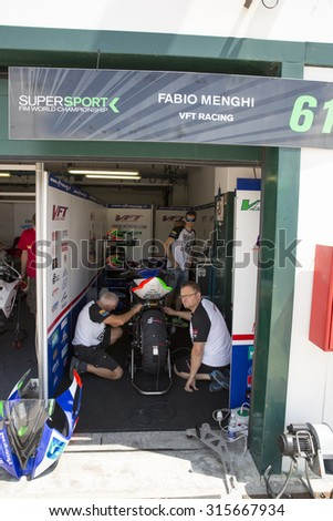 MISANO ADRIATICO, ITALY - JUNE 20, 2015:  mechanic working during the FIM Superbike World Championship - Race at Misano World Circuit on June 20, 2015 in Misano Adriatico, Italy.