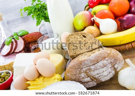 Miscellaneous food products including dairy products, bread and meat - stock photo