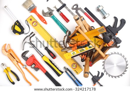 Miscellaneous work tools and toolbox on white background. - stock photo