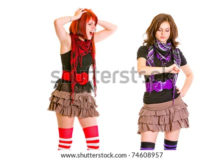 Mischievous  teen girl showing boredom her indignant girlfriend isolated on white - stock photo