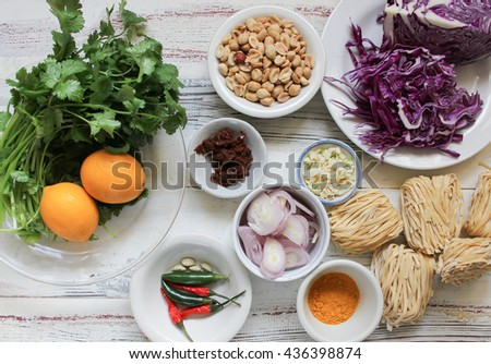 Mise en place photo of ingredients for Khao Soi, a very traditional Thai and Lao noodle dish.  - stock photo