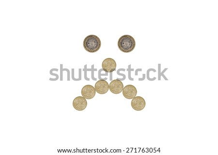 miserable face made out of one pound coins - stock photo