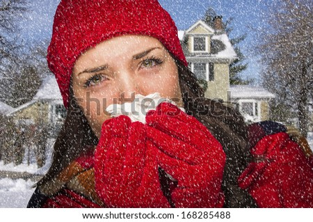 Miserable Sick Woman In Falling Snow Blowing Her Sore Nose With Tissue Outside. - stock photo