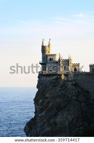 Miskhor, Russia - October 05, 2014: rocky cape Ai-Todor, castle 'Swallow's nest' on top of cliff closeup,  evening light